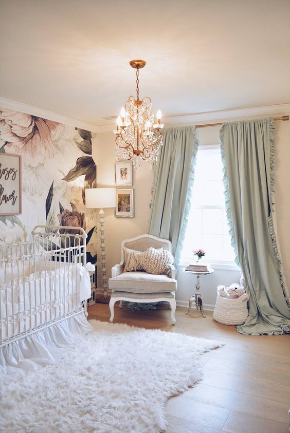 nursery, wooden floor, flowery accent, white wall, crystal chandelier, white crib, white rug, white chair
