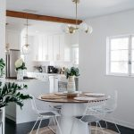 Open Kitchen, Black Floor, White Wall, White Kitchen, Wooden Beams, White Pendant, Wooden Round Table, White Metal Chairs, Cushion