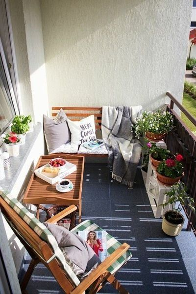 patio, gery floor, cream wall, wooden bench, wooen tray table, wooden folding chair