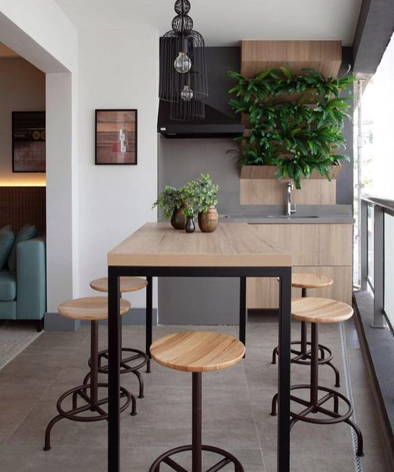 patio, grey floor, white wall, grey accent wall, floating wooden cabinet, wooden table, wooden stools