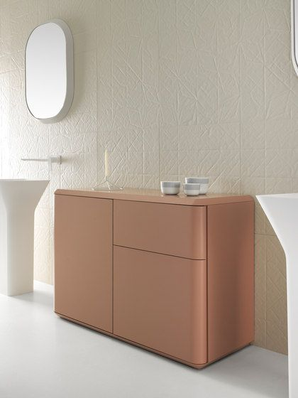 pink vanity, white textured wall, white framed mirror, white tall sink, white floor