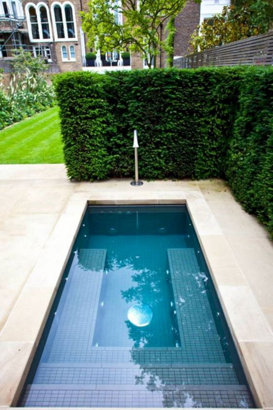 pool, cream marble, grass fence, grass lawn, stairs inside the pool
