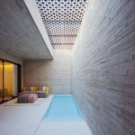 Pool, Stone Wall, Light Concrete Floor, Rectangular Pool, Sofa, Ottoman