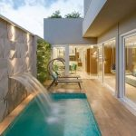 Pool, Wooden Floor, Textured Geometrical Wall, Fontain, Lounge Chairs, Glass Wall And Door
