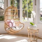 Rattan Swing, Wooden Floor, White Rug, Large Glass Window