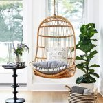 Rattan Swing, Wooden Floor, White Wall, Black Side Table, White Pot