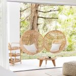 Round Rattan Swings, White Patio, Wooden Round Coffee Table, Wooden Shelves Stroller. Wooden Floor