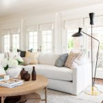 Traditional Living Room, Wooden Floor, White Rug, White Sofa, Rattan Round Coffee Table, Black Floor Lamp, Glass Wall
