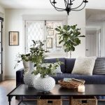 Traditional Living Room, Wooden Floor, White Wall, Black Chandelier, Dark Blue Sofa, Black Coffee Table, Rattan Basket