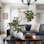 Traditional Living Room, Wooden Floor, White Wall, Black Chandelier, Dark Blue Sofa, Black Coffee Table, Rattan Basket