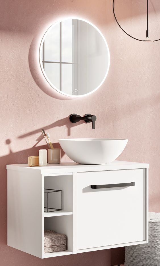 vanity, pink wall, white floating vanity cabinet, white bowl sink, round mirro