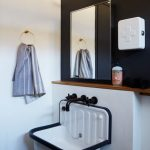 White Farmhouse Floating Sink, White Wall, Black Accent Wall, Wooden Accent