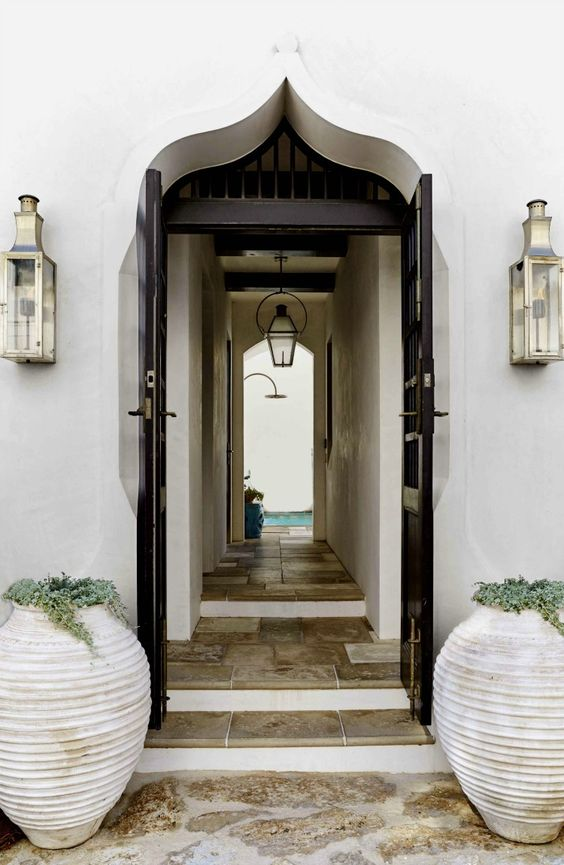 white plain arch door, black door, marble floor, hallway