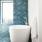 White Round Soaking Tub, Blue Geometrical Wall And Floor Tiles, White Wall, Glass Window
