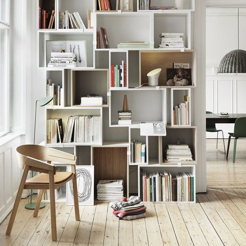 white square boxes for bookshelves, wooden floor, wooden chair