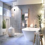 White Square Soaking Tub, Grey Seamless Wall And Floor, Glass Partition, Fairy Lights, White Rattan Basket, Rack, Stool