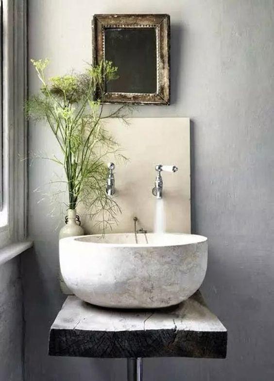 white stone sink, wooden vanity, concrete wall, cream backsplash