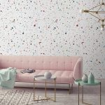 White Terrazzo Marble On The Wall, Pink Sofa, Cream Rug, Tray Coffee Tables, Geometrical Chandelier