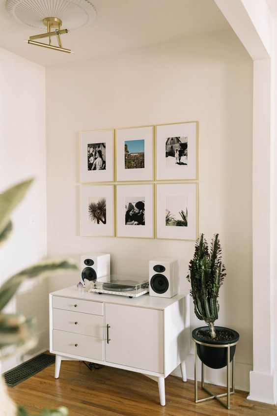 white wooden cabinet, wooden floor, white wall, golden pendant, black pot