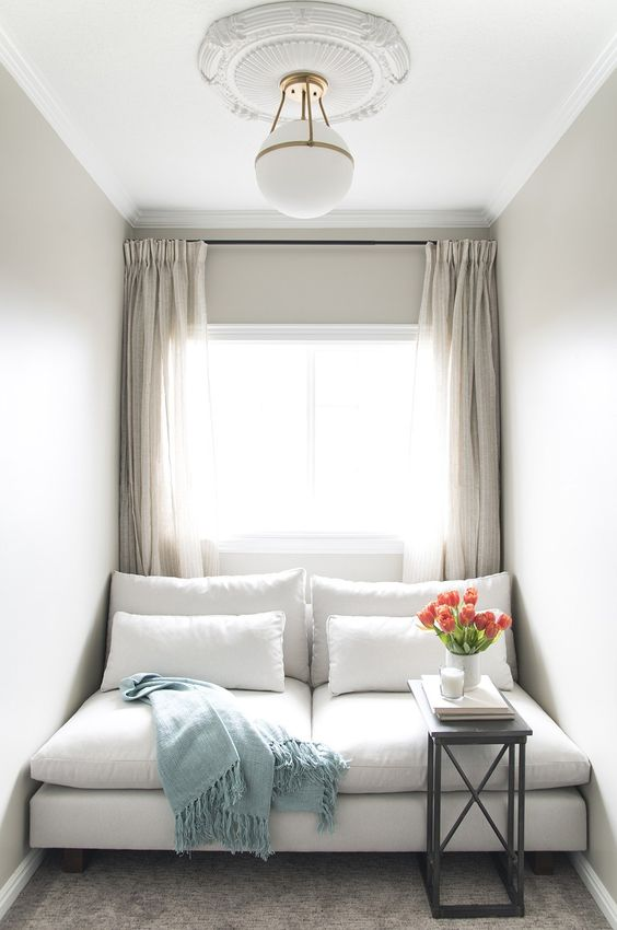 window cushion, grey floor, white wall, white sofa, white pillows, white pendant, white curtain