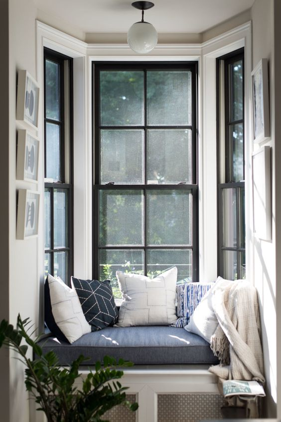 window, white built in bench, blue cushion, glass window, white pendant