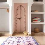 Wooden Arch, Pink Colored, Wooden Door, White Built In Shelves With Arch, Brown Floor, White Patterned Rug