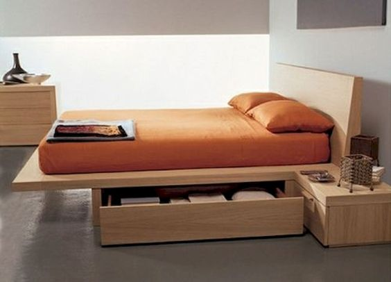 wooden bed platform, drawers under the bed, white wall, wooden side table, wooden cabinet