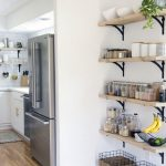 Wooden Floating Shelves, White Wall, Wooden Floor, White Bottom Cabinet White Counter Top, Grey Fridge