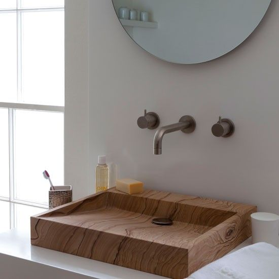wooden sink, white marble counter top, round mirror