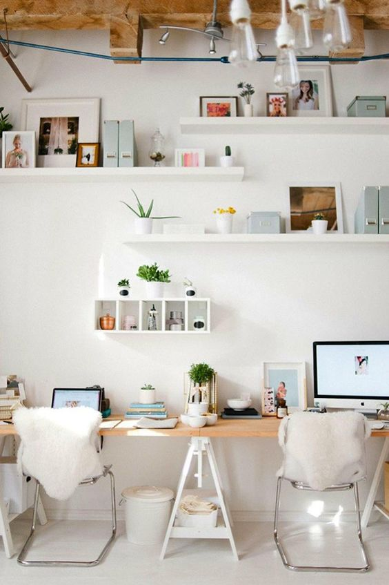 working space, white seamless floor, white wall, white floating shelves, wooden table, triangle legs, metal cair, white pendants