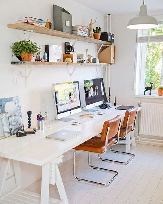 working space, white wooden floor, white wall, grey pendant, white wooden table, brown leather chair, wooden shelves