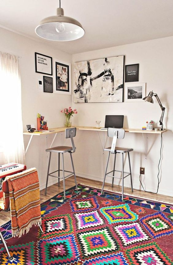 working space, wooden floor, vibrant patterned rug, grey pendant, white wall, floating bar table, grey stools, table lamp