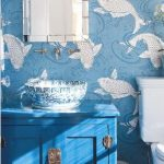 Bathroom, Blue Wallpaper, White Fishes, Blue Cabinet, White Toilet, Mirror, White Sconces