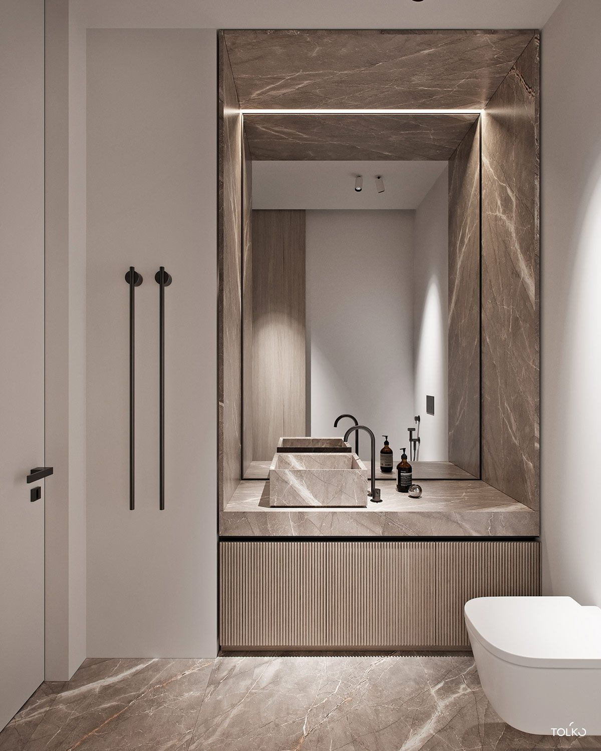 bathroom, brown marble floor, cream wall, brown marble wall and sink, white toilet