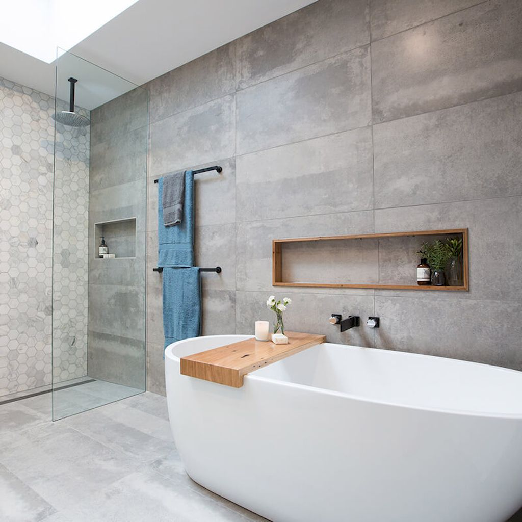 bathroom, neutral floor tiles, neutral wall tiles, neutral hexagonal wall tiles, white tub, wooden tray, indented wall