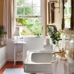 Bathroom, Orange Floor Tiles, White Wall, Cream Wallpaper, White Sink, White Tub, Cream Curtain, White Shelves, White Sconce