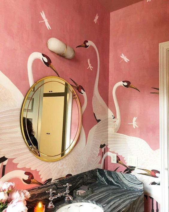 bathroom, pink swan wall, black marble counter top vanity, round golden mirror