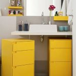 Bathroom Vanity, White Counter Top, Yellow Cabinet, Grey Floor, White Wall, Yellow Shelves