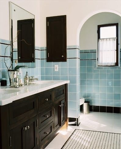 bathroom, white floor tiles, blue wall tiles, white wall, black wooden cabinet with white counter top, mirror