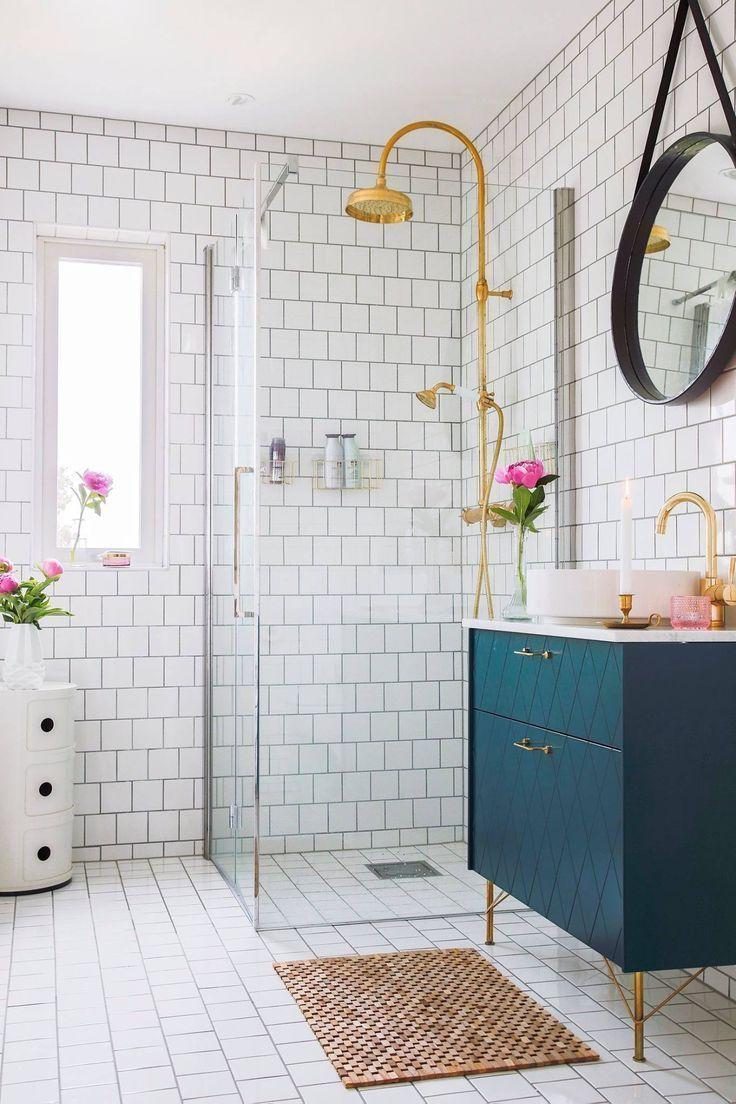 bathroom, white floor tiles, golden faucet, green cabinet, white counter top, white round sink, white floor tiles