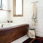 Bathroom, White Floor Tiles, White Wall Tiles, White Wall, Wooden Framed Window, Wooden Floating Shelves, Wooden Covered Tub, Patterned Rug