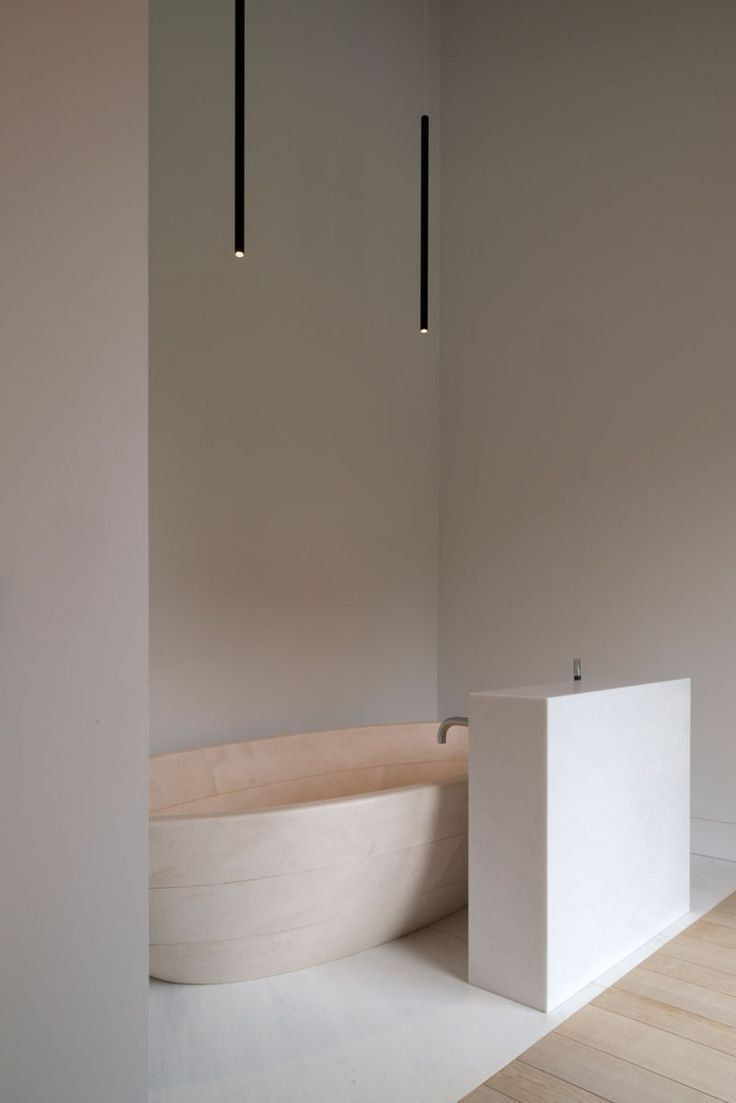 bathroom, white marble floor, wooden floor, white wall, light brown curvy tub