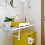 Bathroom, White Vanity Counter, Yellow Square Sink, Yellow Square Shelves, White Wall, White Floaitng Shelves, Round Mirror, White Floor Tiles