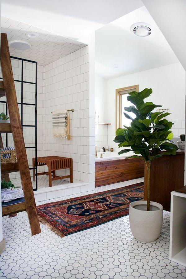 bathroom, white wall, white wall tiles on the shower, white floor tiles, patterned rug, wooden tub, wooden rack