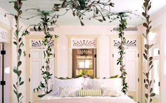 bed frame with twited leaves, cream wall, white floor, white bed