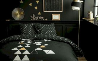 bedroom, black accent wall, wooden floor, black wainscoting, black bedding, golden floor lamp