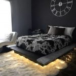 Bedroom, Black Wall, Black Bed Platform, White Lounge Chair, White Rug, Black Floor, Black Bedside Cabinet