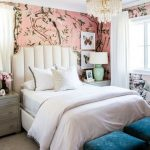 Bedroom, Grey Floor, Pink Flower Wallpaper, White Headboard, White Bedding, Grey Wooden Side Cabinet, White Chandelier, Blue Velvet Ottomans