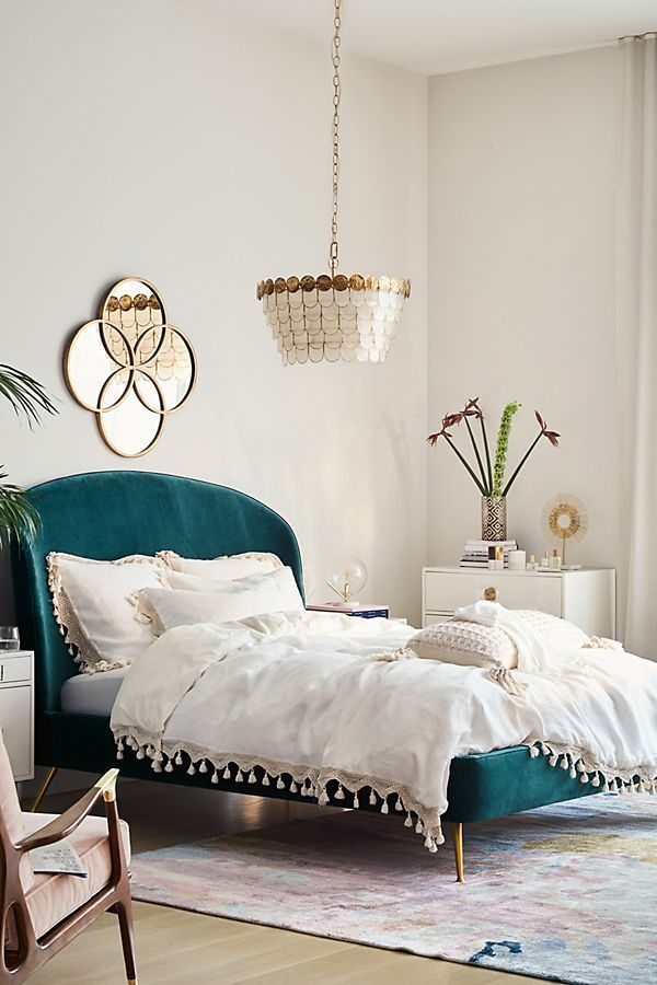 bedroom, wooden floor, white wall, green velvet bed platform, white side cabinet, wooden chair, white chandelier