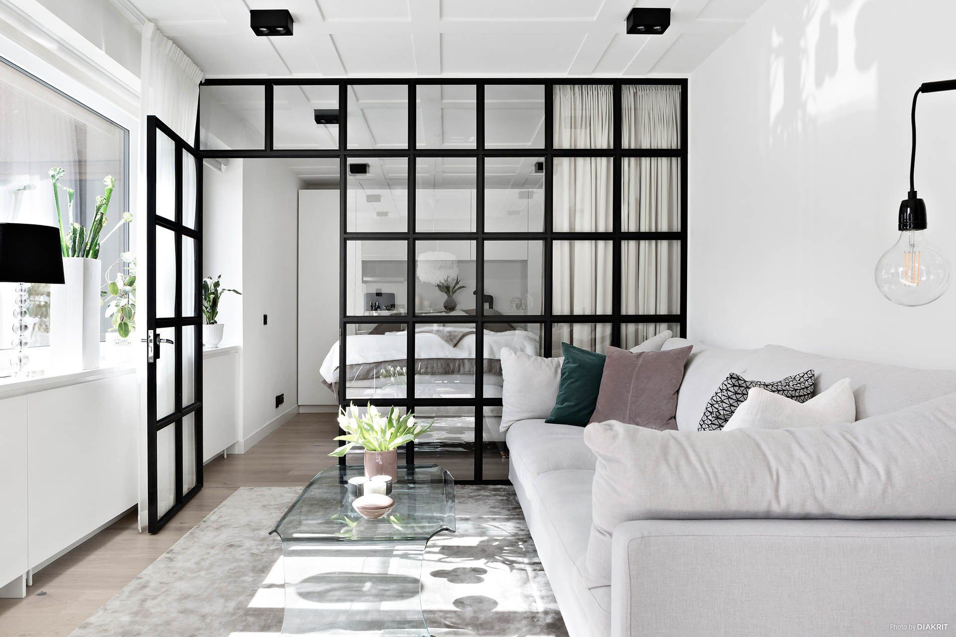 bedroom, wooden floor, white wall, white sofa, glass partition, glass door
